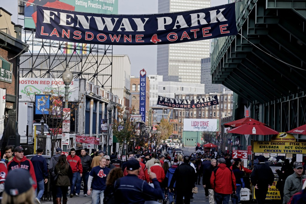 Fans make their way to Fenway Park for Game 6 of baseball's World Series between the Boston Red Sox and the St. Louis Cardinals Wednesday, Oct. 30, 2013, in Boston.
