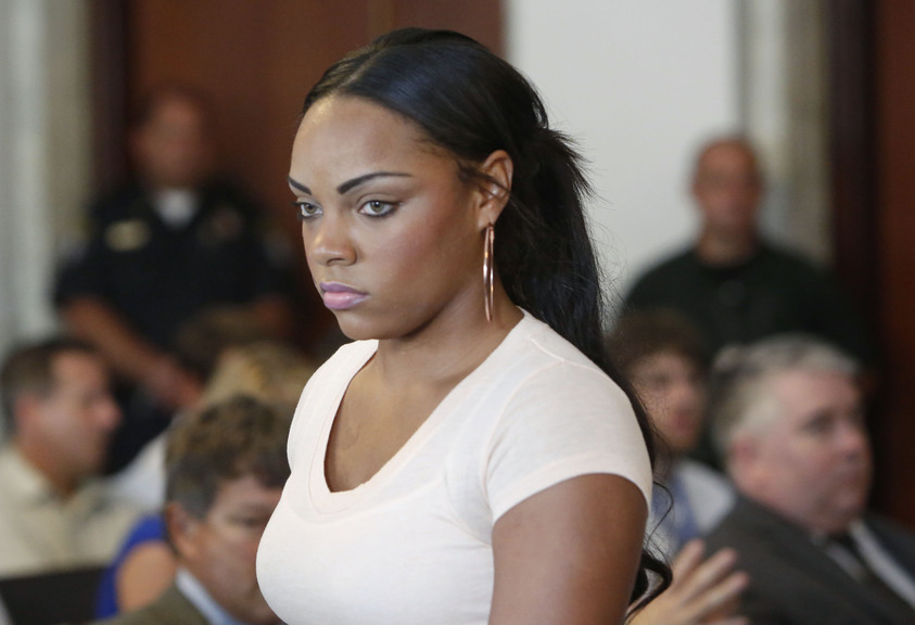Shayanna Jenkins, girlfriend of former New England Patriots' Aaron Hernandez, stands in superior court, in Fall River, Mass., Tuesday, Oct. 15, 2013, during her arraignment on a perjury charge in connection with the killing of Hernandez's friend. Authorities say Jenkins, 24, was untruthful in her testimony before the grand jury investigating the death of Odin Lloyd.