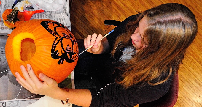 Spooky pumpkin: Kyara Dawbin paints a pumpkin during the After School Art Program on Wednesday at Johnson Hall in Gardiner.