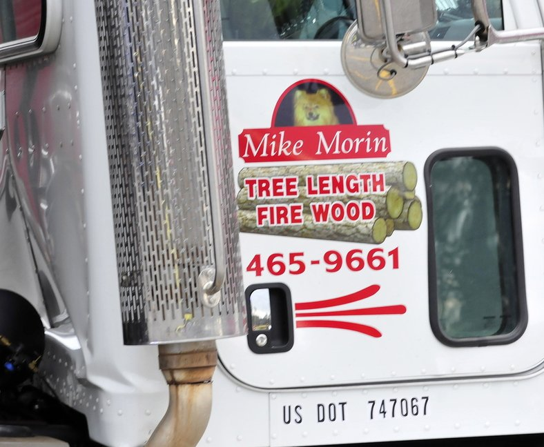 MAN'S BEST FRIEND: A photo of truck driver Mike Morin's Pomeranian dog, Javis, is on the side of his truck. Morin was killed Monday morning when the truck rolled over him before crashing into the Pizza Hut restaurant in Skowhegan.