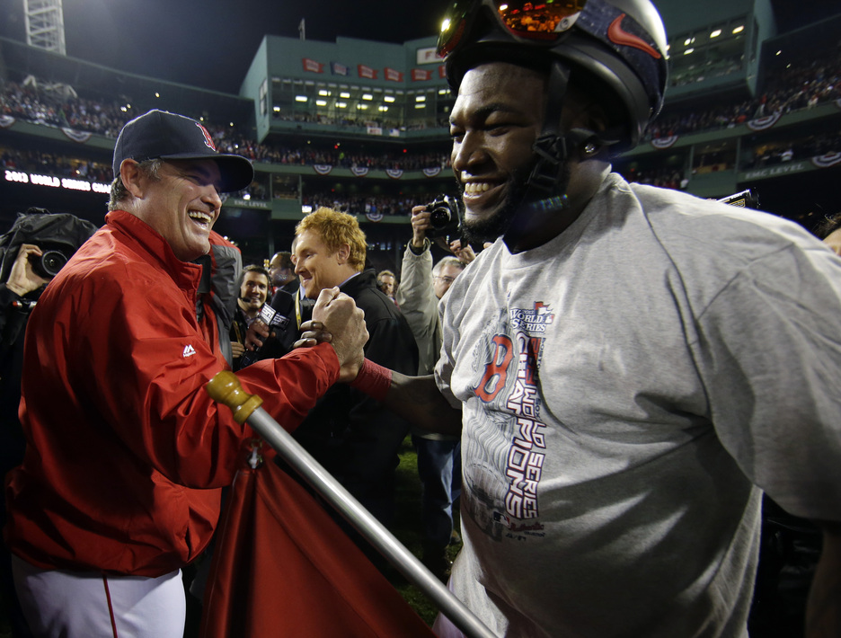 Boston Red Sox manager John Farrell celebrates with David Ortiz after Game 6 of baseball's World Series against the St. Louis Cardinals Wednesday, Oct. 30, 2013, in Boston. The Red Sox won 6-1 to win the series.