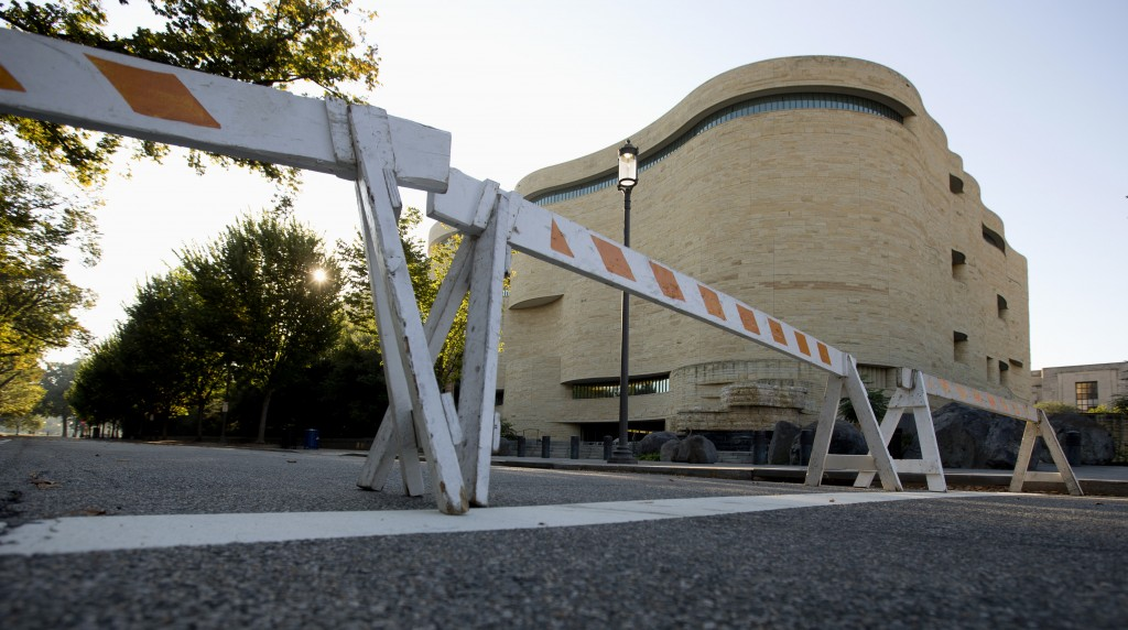 Barricades are posted in front of the closed Smithsonian National Museum of the American Indian in Washington, Wednesday, Oct. 2, 2013. The political stare-down on Capitol Hill shows no signs of easing, leaving federal government functions _ from informational websites, to national parks, to processing veterans' claims _ in limbo from coast to coast. Lawmakers in both parties ominously suggested the partial shutdown might last for weeks.
