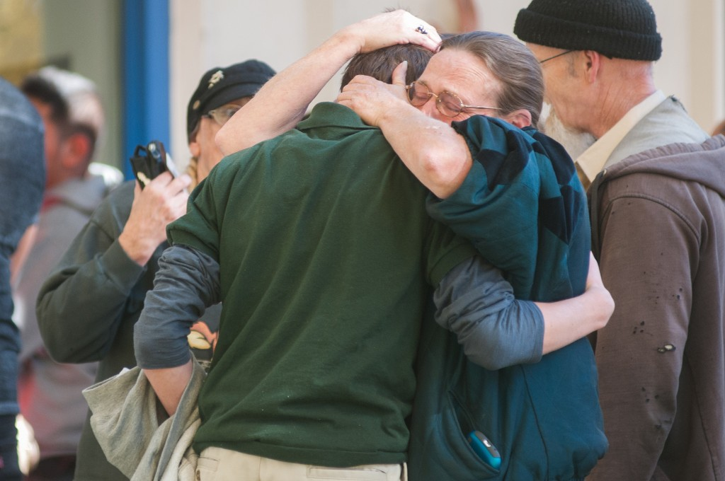 A Sparks Middle School student cries with family members after being released from Agnes Risley Elementary School, where some students were evacuated to after a shooting at Sparks Middle School in Sparks, Nev. on Monday, Oct. 21, 2013 in Sparks, Nev. A student at the Sparks Middle School opened fire on campus, killing a staff member who was trying to protect other children, police said Monday.