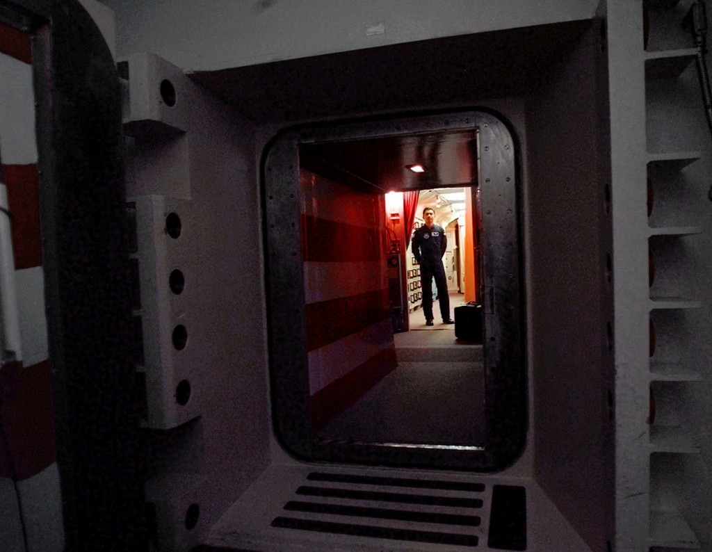 An Air Force missile crew commander stands at the door of his launch capsule 100 feet underground where he and his partner are responsible for 10 nuclear-armed ICBM's, in north-central Colorado.