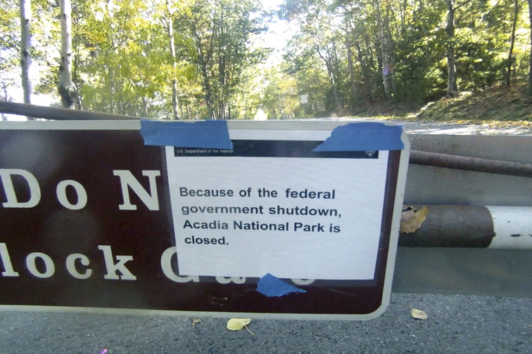 A sign on a closed gate near the entrance to the Park Loop Road in Acadia National Park tells visitors Thursday that the park is closed because of the government shutdown.