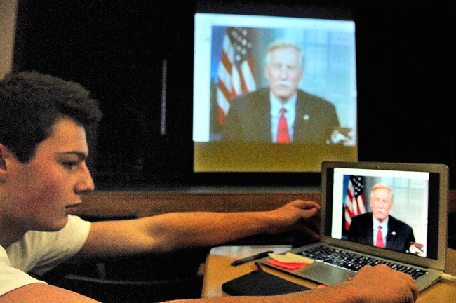 Matthew Mills turns the laptop back to face the rest of the audience after asking Sen. Angus King, I-Maine, a question about national debt during a Skype session today at Hall-Dale High School in Farmingdale.