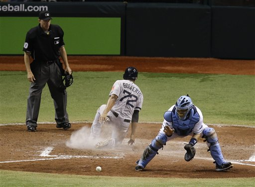 Tampa Bay Rays catcher Jose Molina, right, waits for a throw as Boston Red Sox's Xander Bogaerts (72) slides home to score a run in the ninth inning of Game 4 of baseball's American League division series, Tuesday in St. Petersburg, Fla. Boston won the game 3-1. Tropicana Field;Tampa Bay Rays