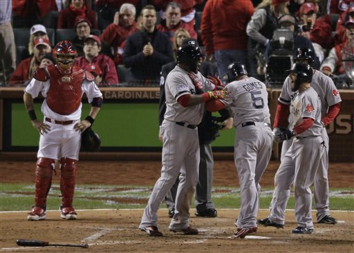 Boston Red Sox's Jonny Gomes (5) celebrates at home after hitting a three-run home run during the sixth inning of Game 4 of baseball's World Series against the St. Louis Cardinals Sunday, Oct. 27, 2013, in St. Louis. (AP Photo/Charlie Riedel) MLB