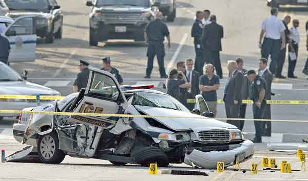 A damaged Capitol Hill police car is surrounded by crime scene tape after a car chase and shooting on Capitol Hill in Washington on Oct. 3. The driver, a mentally ill woman, was shot and killed when she tried to ram through a White House barricade, witnesses and officials said.