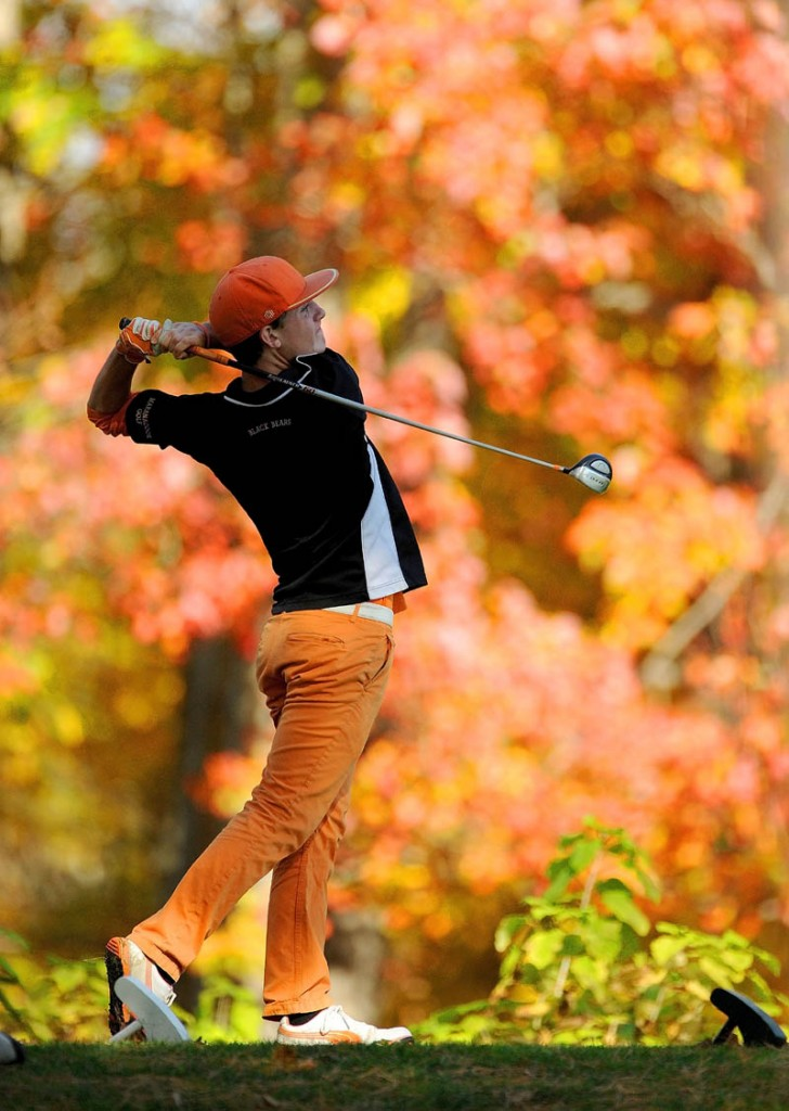 TIME TO WIN: Maranacook High School's Luke Ruffing tees off on the 18th hole during the individual golf state championships Saturday at Natanis Golf Course in Vassalboro. Ruffing shot 71 to win the Class B title.