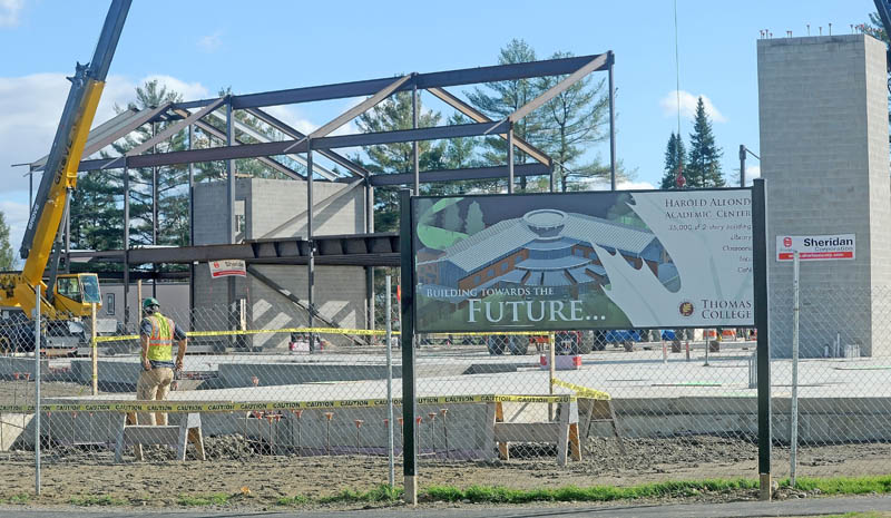 Sheridan Construction works to put steel beams in place during the construction of the new Alfond Academic Center at Thomas College on Friday.