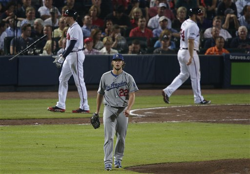 Los Angeles Dodgers starting pitcher Clayton Kershaw (22) walks to the mound after striking out Atlanta Braves first baseman Freddie Freeman (5) in the sixth inning of Game 1 of the National League Divisional Series, Thursday, Oct. 3, 2013, in Atlanta. (AP Photo/Dave Martin) Turner Field
