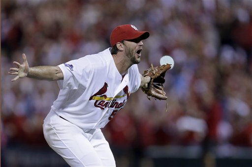 St. Louis Cardinals pitcher Adam Wainwright celebrates after striking out Pittsburgh Pirates' Pedro Alvarez for the final out of Game 5 of a National League baseball division series, Wednesday, Oct. 9, 2013, in St. Louis. The Cardinals won 6-1, and advanced to the NL championship series against the Los Angeles Dodgers. (AP Photo/Charlie Riedel)