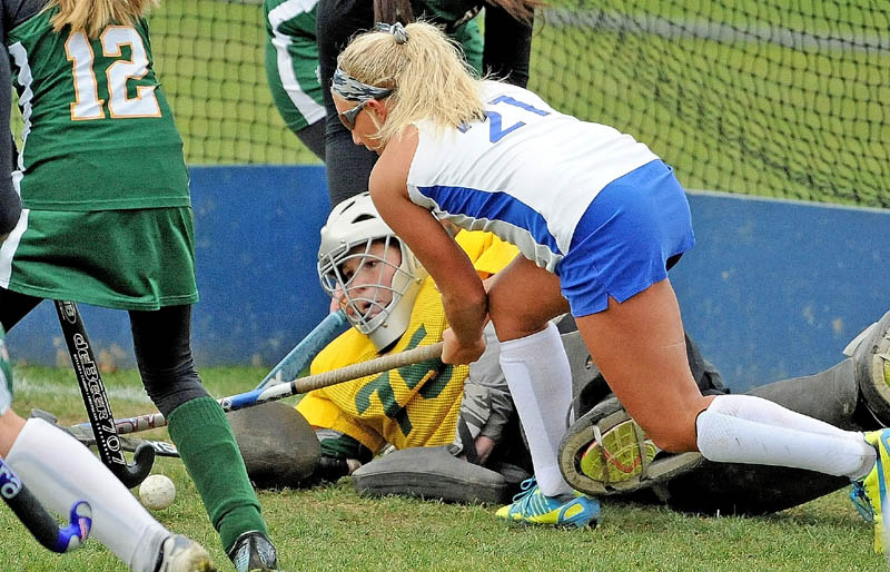 Lawrence High School's Julia Lawrence, 21, tries to get the rebound in front of the Oxford Hills High School goalie Shannon Murch, 75, in the second half in Fairfield on Thursday. Lawrence defeated Oxford Hills 1-0.