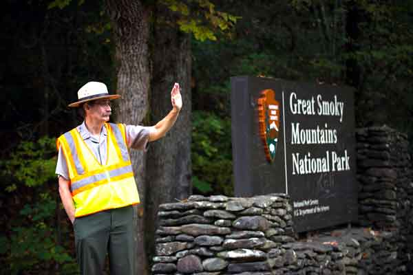 OPEN FOR BUSINESS: Great Smoky Mountains National Park Superintendent Dale Ditmanson greets visitors to the reopened park near Townsend, Tenn., on Wednesday.