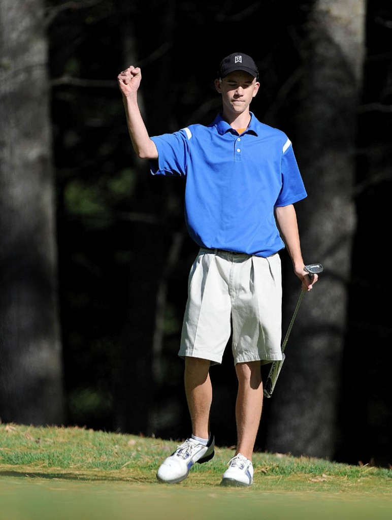 Madison High School's Ty Cowan pumps his fist after sinking a birdie putt on the 16th hole Wednesday during the Mountain Valley Conference qualifier at Natanis Golf Course in Vassalboro. Cowan qualified for the individual tournament with an 83.