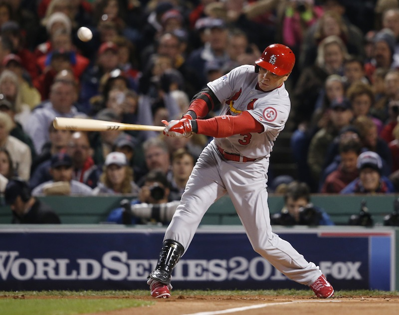 St. Louis Cardinals' Carlos Beltran hits a single off Boston Red Sox starting pitcher John Lackey during the first inning of Game 2 of baseball's World Series Thursday, Oct. 24, 2013, in Boston. MLB