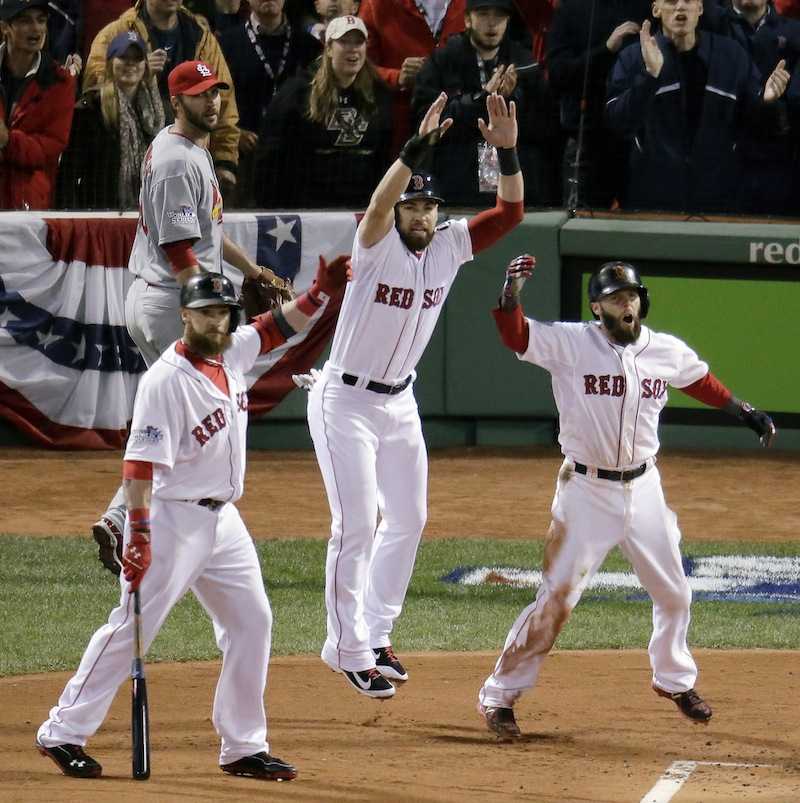 St. Louis Cardinals starting pitcher Adam Wainwright, left, rear watches as Boston Red Sox's Jonny Gomes, left, Jacoby Ellsbury, center, and Dustin Pedroia, celebrate a three-run scoring double by Mike Napoli during the first inning of Game 1 of baseball's World Series Wednesday, Oct. 23, 2013, in Boston. MLB