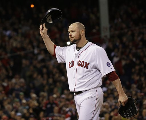 Boston Red Sox starting pitcher Jon Lester acknowledges the crowd as he leaves the game during the eighth inning of Game 1 of baseball's World Series against the St. Louis Cardinals Wednesday, Oct. 23, 2013, in Boston. (AP Photo/David J. Phillip) MLB