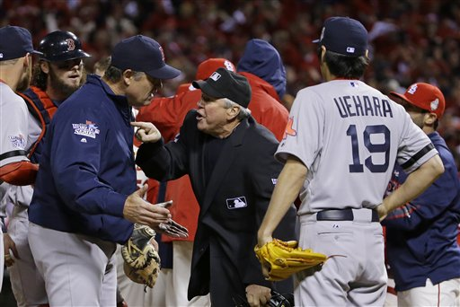 Boston Red Sox manager John Farrell argues with home plate umpire Dana DeMuth after St. Louis Cardinals scored the winning run on an obstruction play during the ninth inning of Game 3 of baseball's World Series Saturday, Oct. 26, 2013, in St. Louis. The Cardinals won 5-4 to take a 2-1 lead in the series. (AP Photo/Matt Slocum) MLB