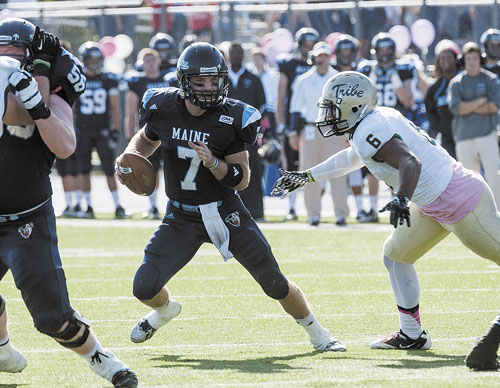 WHO'S OPEN? Maine quarterback Marcus Wasilewski (7) is tightly defended by William and Mary defender Airek Green (6) in the first half Saturday in Orono. Wasilewski went over 4,000 passing yards in his career in the Black Bears' 34-20 win.