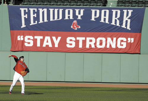HERE WE GO: Boston's Koji Uehara throws during practice Monday in Boston. The Red Sox are preparing to play the St. Louis Cardinals in Game 1 of the World Series on Wednesday.