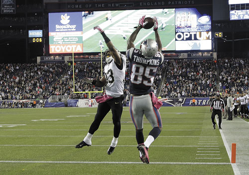 NICE GRAB: New England Patriots wide receiver Kenbrell Thompkins (85) catches the winning touchdown against New Orleans Saints cornerback Jabari Greer in the fourth quarter Sunday in Foxborough, Mass.