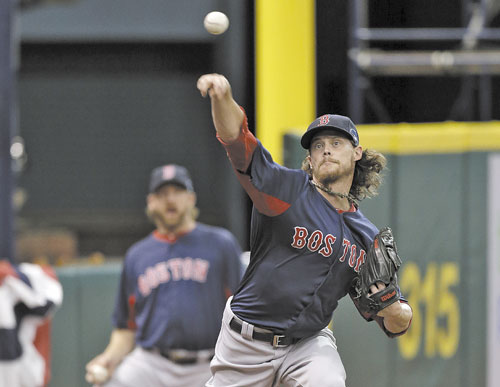 GETTING PREPARED: Boston Red Sox starting pitcher Clay Buchholz throws a bullpen session during practice for today's Game 3 of the American League Division Series against the Tampa Bay Rays on Sunday in St. Petersburg, Fla.