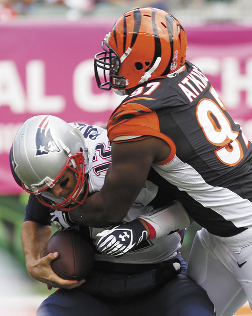 GOING NOWHERE: New England Patriots quarterback Tom Brady (12) is sacked by Cincinnati Bengals defensive tackle Geno Atkins in the first half Sunday in Cincinnati.