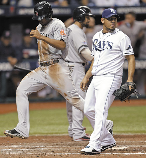 SPEED HELPS OUT: Tampa Bay pitcher Joel Peralta, right, looks back as Boston's Xander Bogaerts scores on a wild pitch by Peralta in the seventh inning in Game 4 of an American League Division Series on Tuesday in St. Petersburg, Fla.