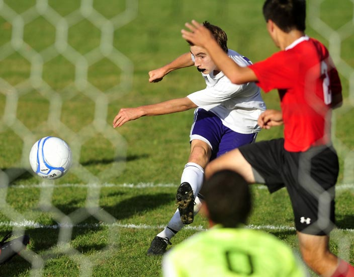 TAKE THE SHOT: Waterville Senior High School's Michael Oliveira takes a shot on goal against Camden Hills Regional High School in the first half of their game Friday in Waterville.