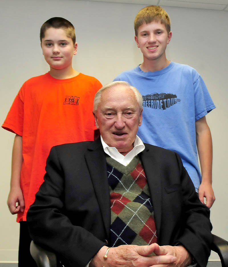 Red Sox baseball fan Charlie Gaunce is surrounded by his grandsons Daniel, left, and C.J. Gaunce.