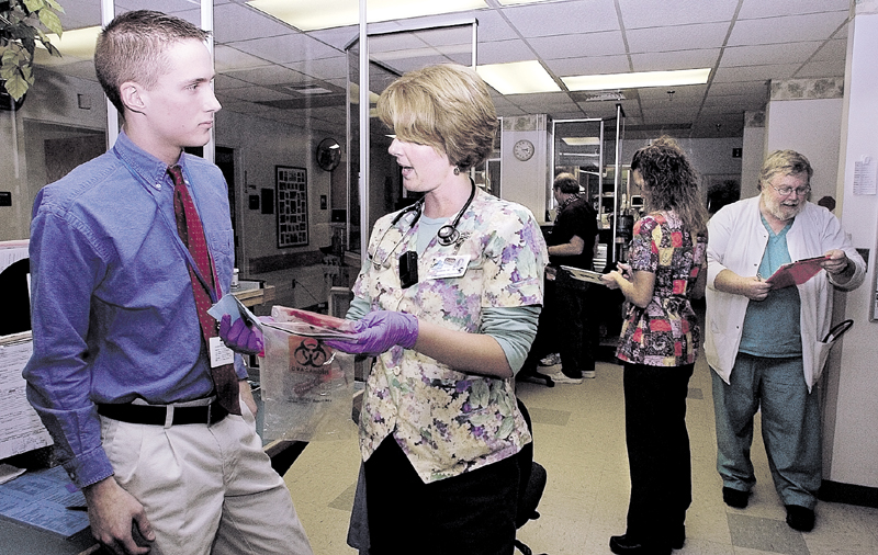 Brandon Giberson, then 17, speaks with registered nurse Bobbi McCarthy in 2005 about blood in the emergency room nurses' station, at Redington-Fairview General Hospital in Skowhegan, where he volunteered. Giberson was then an Upper Kennebec Valley Memorial High School senior.