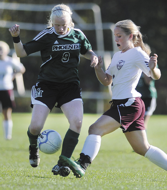 Monmouth Academy's Haley Fletcher, right, battles Spruce Mountain's Audrey Mercier for the ball during the Mustangs' 3-1 loss to the Phoenix on Tuesday in Monmouth.
