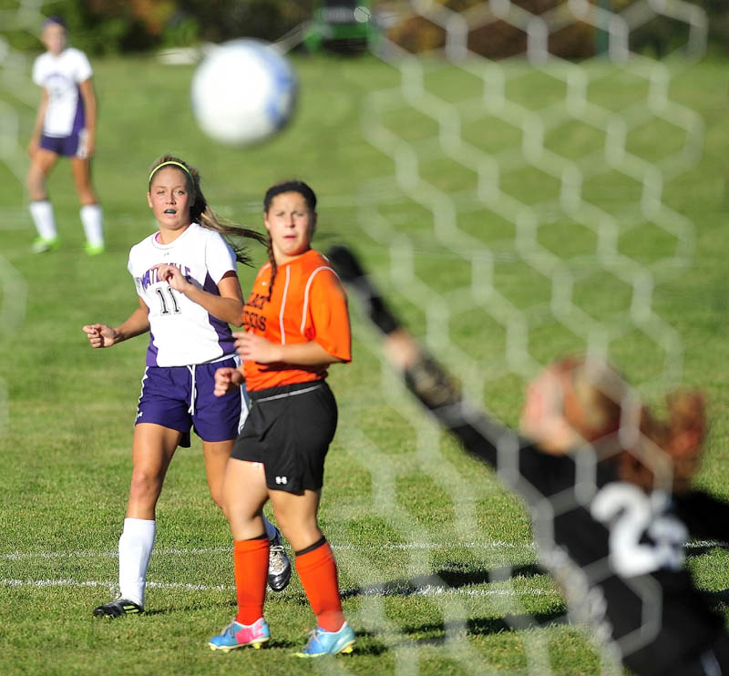 Waterville Senior High School's Colleen O'Donnell, 11, back, watches as her shot on goal gets past Winslow High School goalie Hillary Libby, 25, in the first half in Waterville on Tuesday. Waterville defeated Winslow 3-0.