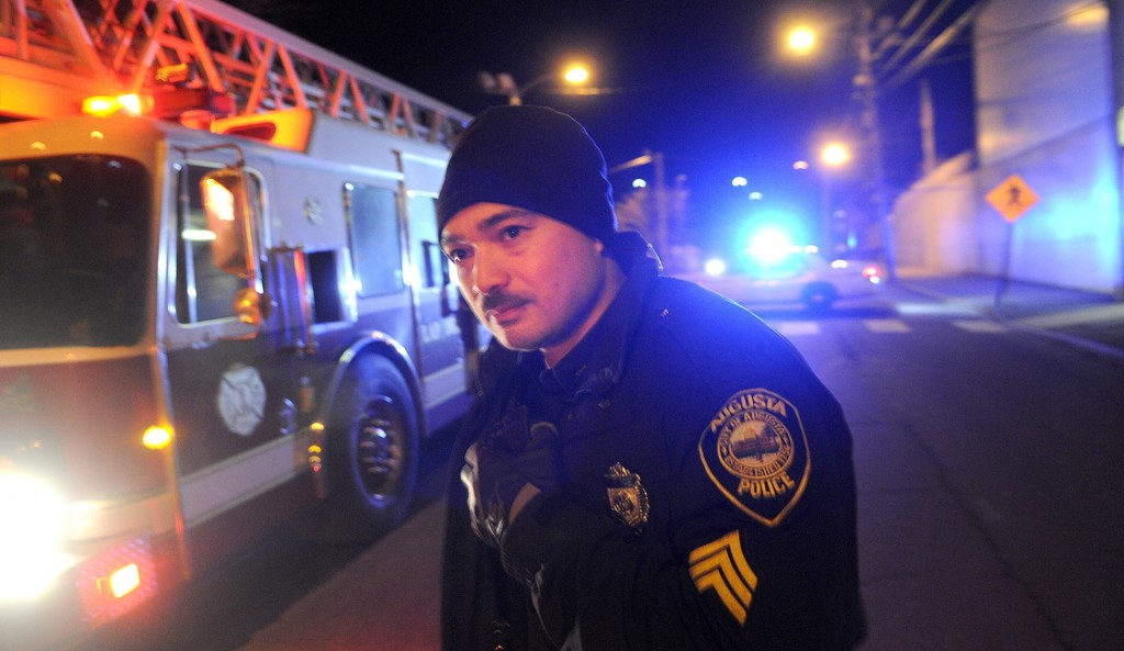 FAILED TEST: Augusta Police Dept. Sgt. Vincente Morris looks down Arsenal Street after the street buckled Tuesday night above a natural gas pipeline, resulting in evacuations of nearby residents. Authorities determined that air in a Summit Natural Gas pipeline erupted during a pressure test.