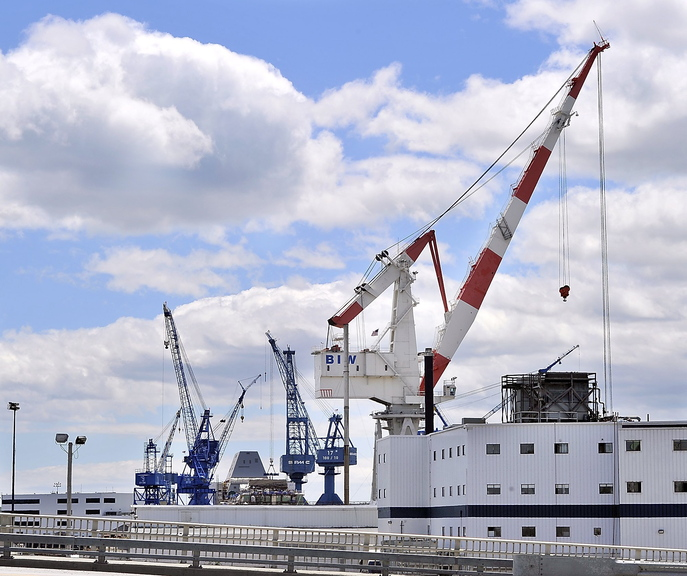 Cranes fill the skyline in Bath. Bath Iron Works, one of Maine's largest employers, plans to lay off another 81 workers later this month.