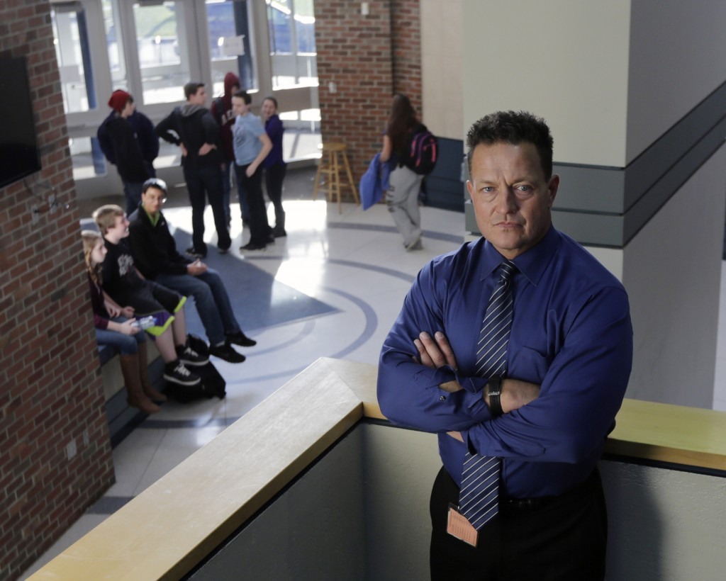 "Columbia High School Principal John Sawchuk poses at the school recently in East Greenbush, N.Y. In 2004 Sawchuk found himself wrestling a 16-year-old student for the loaded shotgun the boy used to wound a teacher. ""That was the most terrifying moment of my life, something I will never forget,"" Sawchuk said. ""I kept thinking, if I let go, he's going to kill me."""