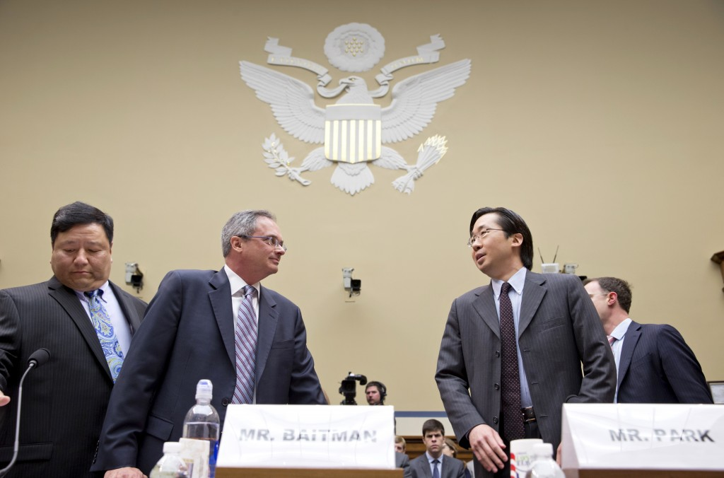 Todd Park, the U.S. chief technology officer at the White House Office of Science and Technology Policy, right, speaks with Frank Baitman, the deputy assistant secretary for information technology at the Health and Human Services Department, center, as they and other technology officials arrive to testify before the House Oversight Committee about problems with the implementation of the Obamacare healthcare program, and specifically, the HealthCare.gov website, on Capitol Hill in Washington on Wednesday. At left is Henry Chao, deputy chief information officer for Medicare and Medicaid Services.