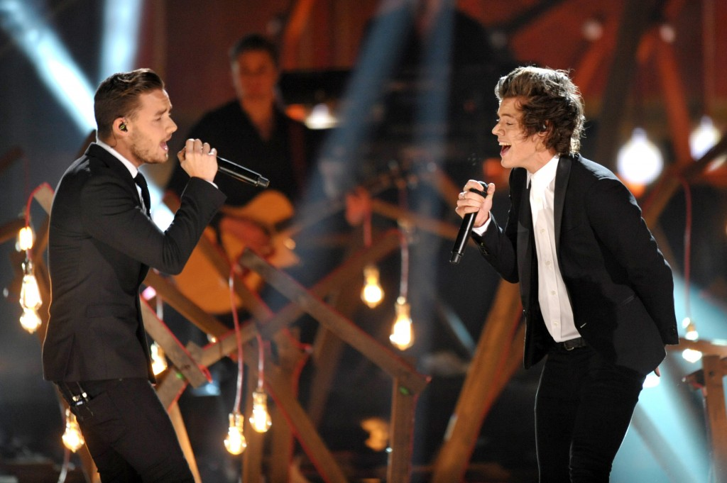 Liam Payne, left, and Harry Styles of the musical group One Direction perform on stage at the American Music Awards at the Nokia Theatre L.A. Live on Sunday, Nov. 24, 2013, in Los Angeles.