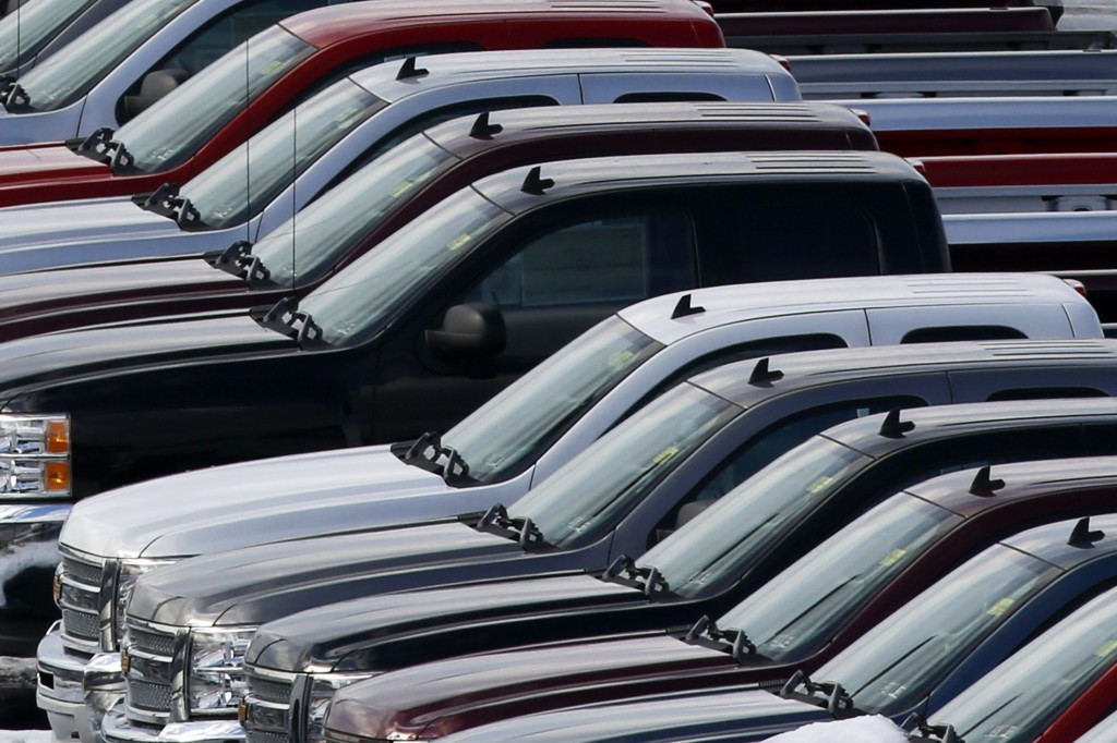 Chevy trucks line the lot of a dealer in Murrysville, Pa. At General Motors Co., which includes the Chevy brand, sales rose 16 percent as its full-size pickup trucks rebounded from a poor showing in September.