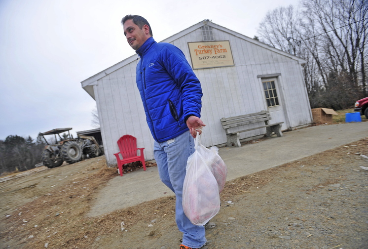 bird pickup: Chris Flye of Waterville leaves Greaney's Turkey Farm with two fresh turkeys for Thanksgiving dinner on Tuesday. Frye has never tried a free-range, grain fed turkey before.