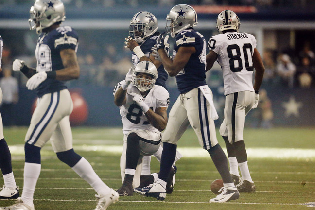 Oakland Raiders tight end Mychal Rivera (81) celebrates after a run against the Dallas Cowboys during the first half of an NFL football game, Thursday, Nov. 28, 2013, in Arlington, Texas. (AP Photo/Brandon Wade)