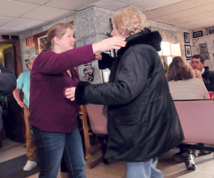 GRATEFUL: Louise Bougie, right, hugs What's For Supper restaurant owner Laura Lorette after a Thanksgiving Day meal at the Norridgewock restaurant today.