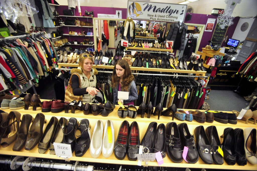 BLACK FRIDAY: Monique Pelletier, left, shops for deals with her daughter Alana Monk, 11, during the Black Friday sales at Madlyn's New and Used Consignment Shop on Main Street in Waterville.