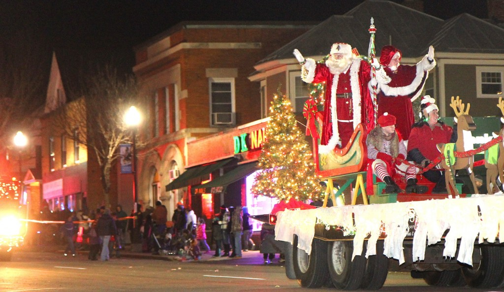 Photo by Jeff Pouland HERE COMES SANTA: Santa and Mrs. Claus wave to the crowd during the 8th annual Parade of Lights and opening of Kringleville on Friday night in downtown Waterville. Photo by Jeff Pouland HERE COMES SANTA: Santa and Mrs. Claus wave to the crowd during the 8th annual Parade of Lights and opening of Kringleville on Friday night in downtown Waterville.