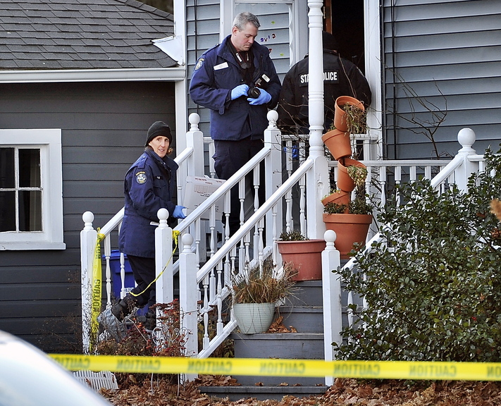 Evidence technicians enter the Westbrook apartment at 318A Main St., where state police were investigating an apparent murder-suicide Saturday. Police say Patrick Milliner, 30, shot and killed Matthew Rairdon, 22, and then himself.