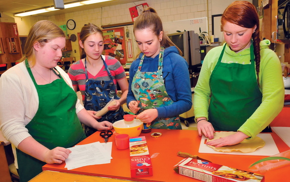 FOOD FOR THOUGHT: Skowhegan Area High School students in the Basic Foods class prepare to make meals recently. From left are Emily Greaney, Mariah Bonneau, Laura Wolters and Monique Thompson.