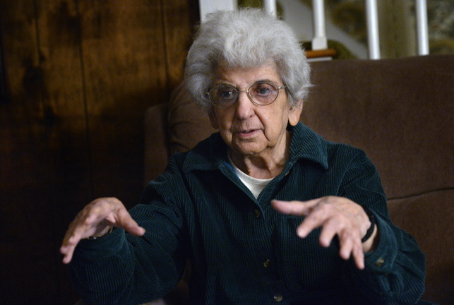 Shawn Patrick Ouellette/Staff Photographer Pauline Young, a combat nurse in World War II and Korea, shares her experiences at her home.