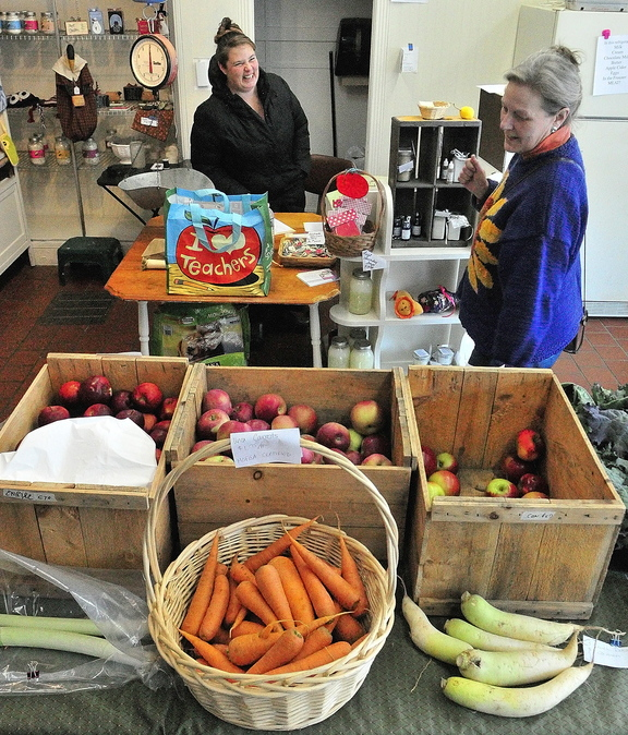 Local FOOD: Owner Marcina Johnson, left, chats with customer Sandy Wachholz recently at Founding Farmers Community Market in Gardiner, which sells locally grown food.